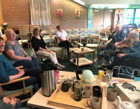 Residents Enjoy Coffee With Neighbours