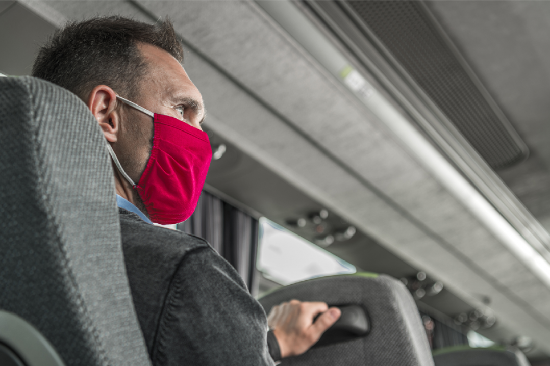 Man on bus wearing mask