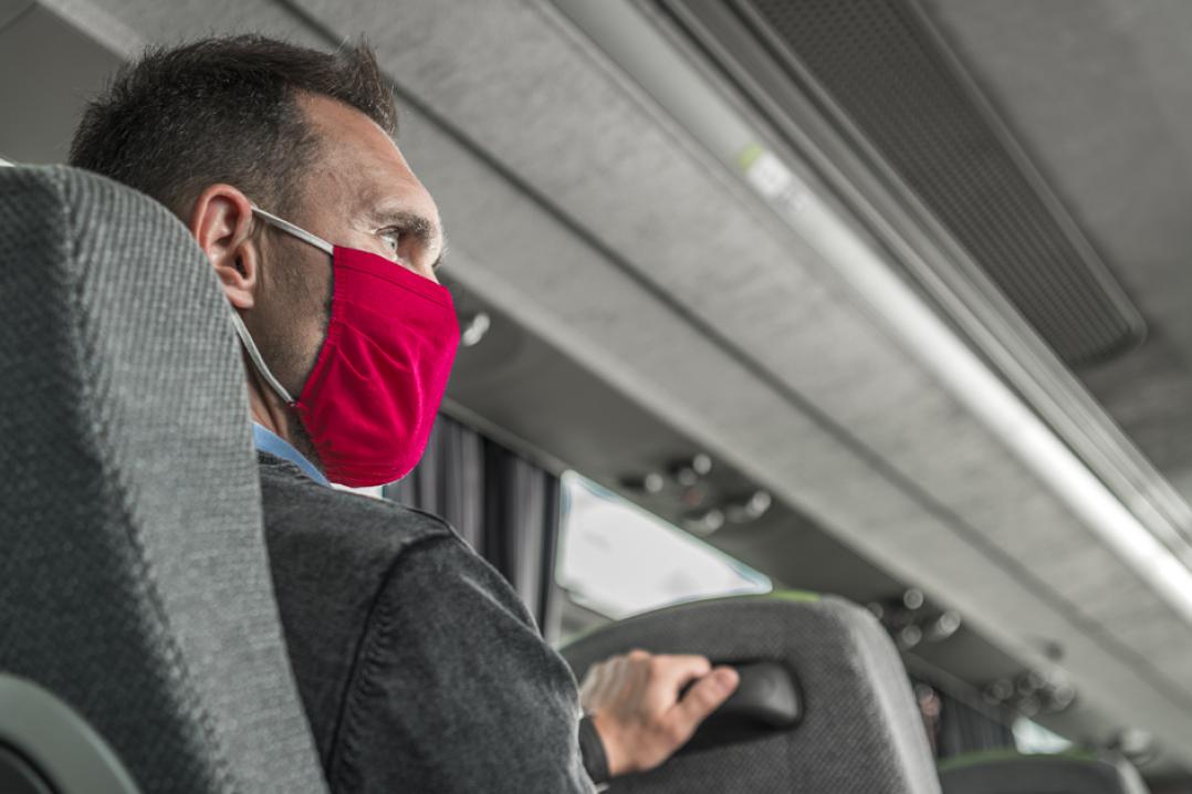 Man on bus wearing mask