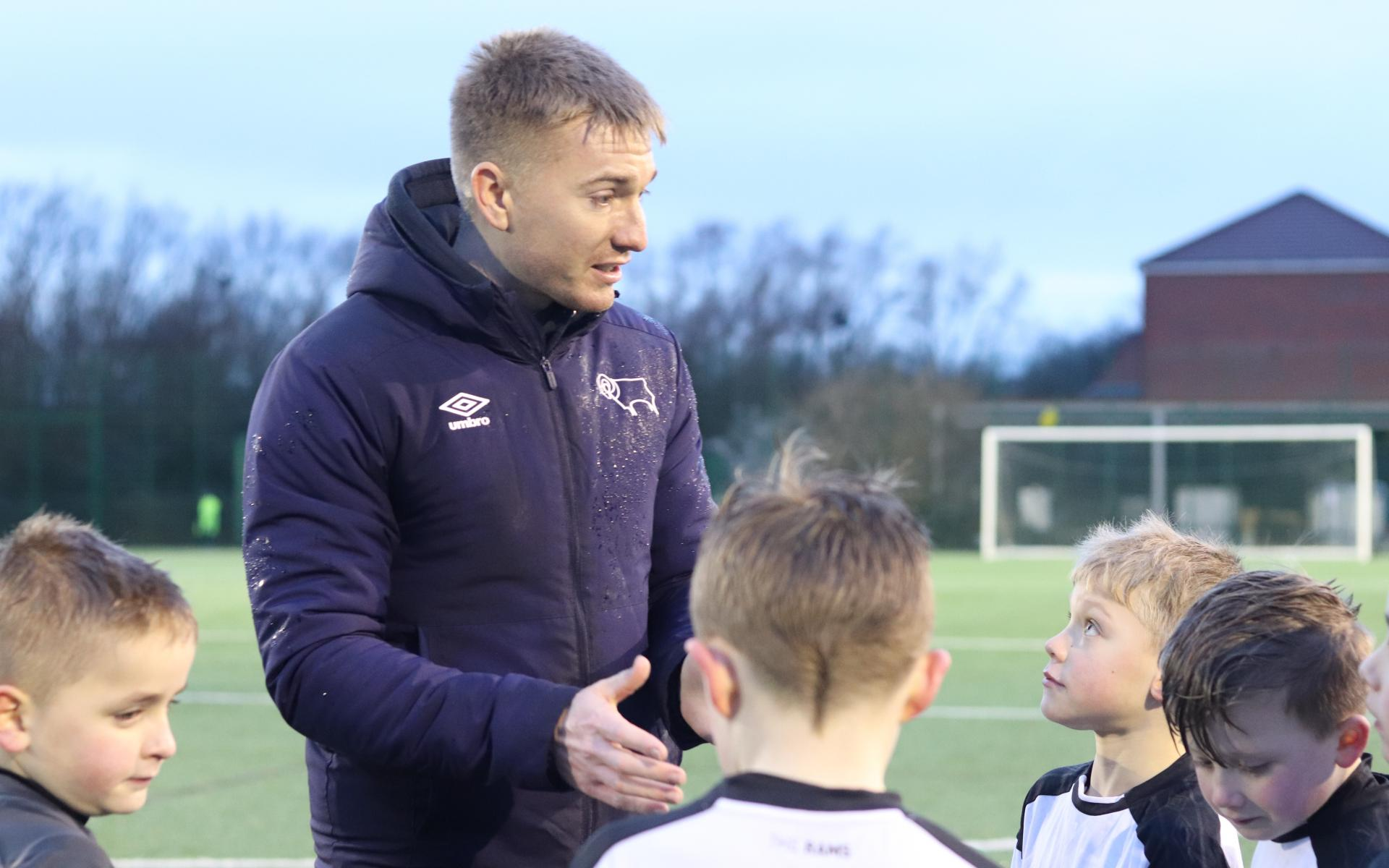 Sam Howard coaching children
