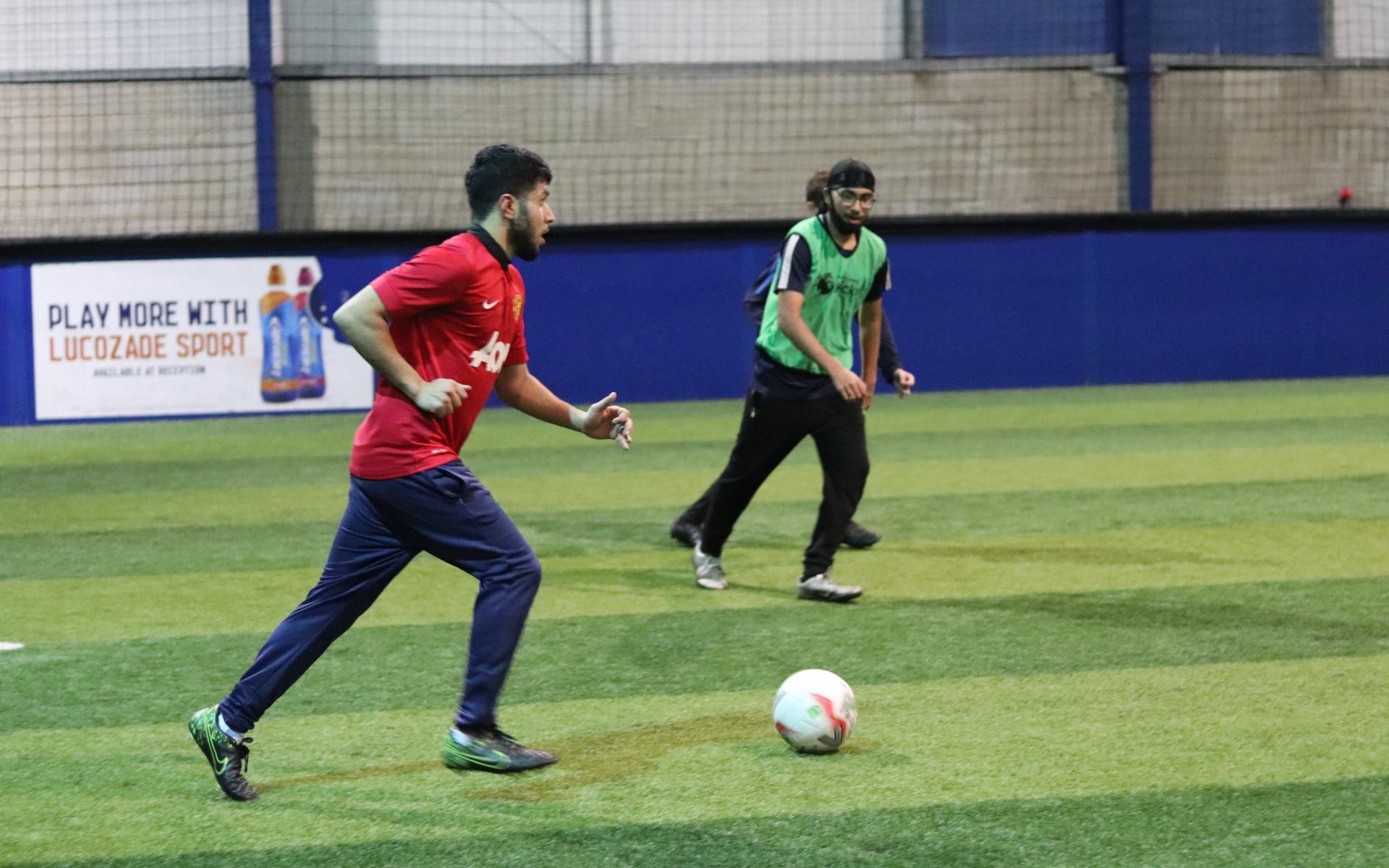 Teenagers playing football