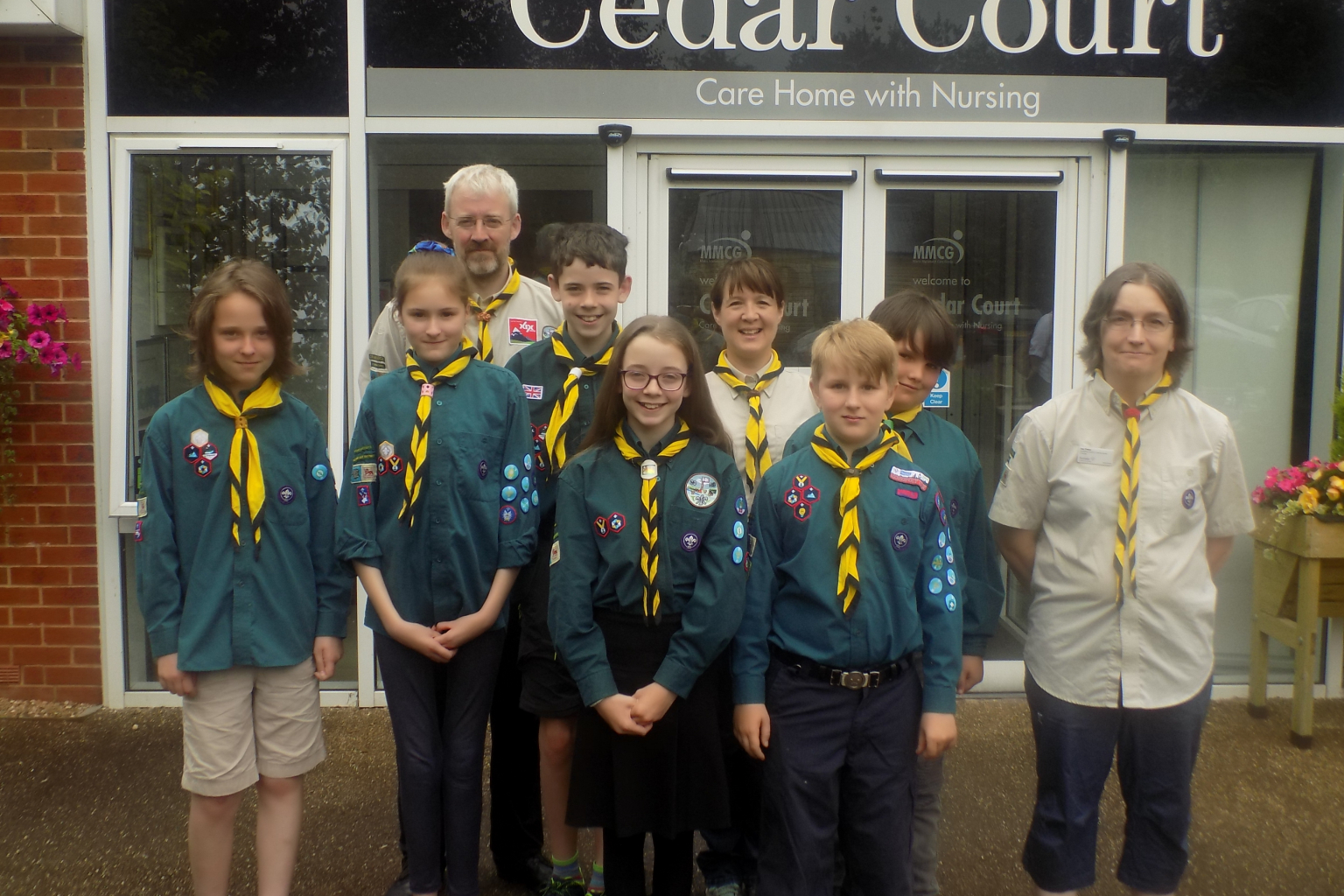 Cranleigh Scouts and staff members pictured outside of Cedar Court