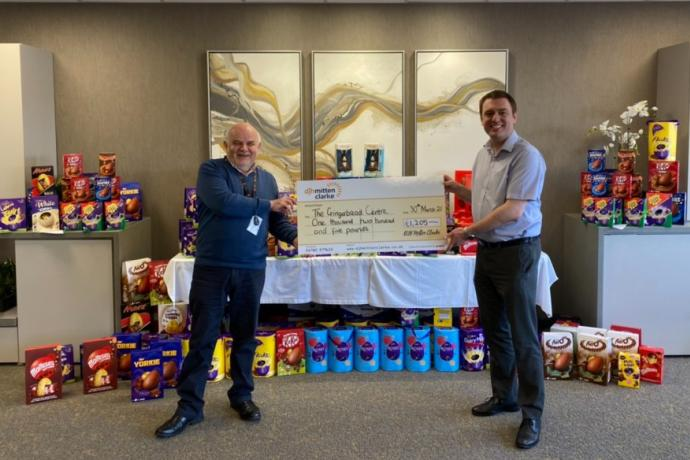 DJH Mitten Clarke presenting cheque to Chris Belyavin of The Gingerbread Centre