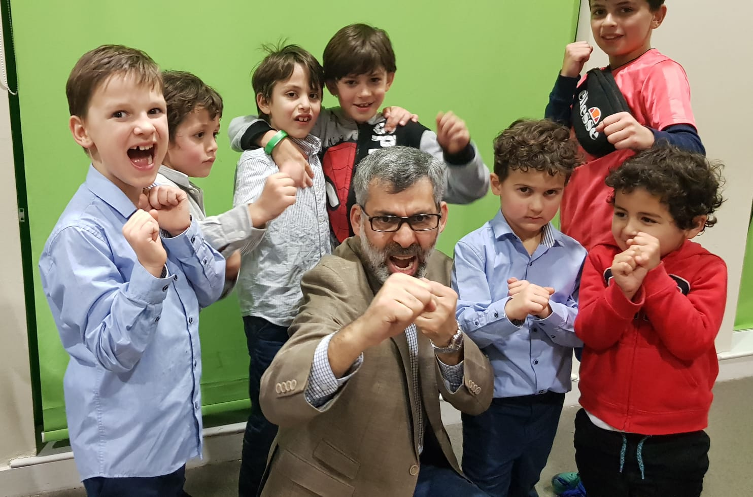 Samer with his students