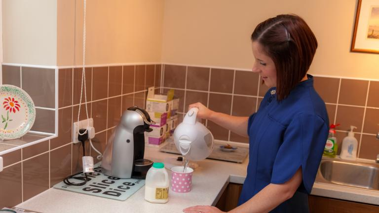 Domiciliary Carer in the kitchen