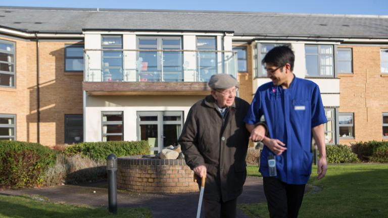 Carer and resident in the garden