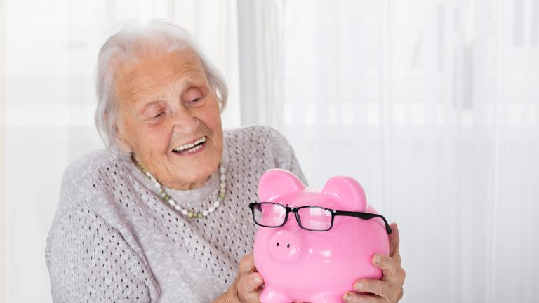 Older lady with piggy bank