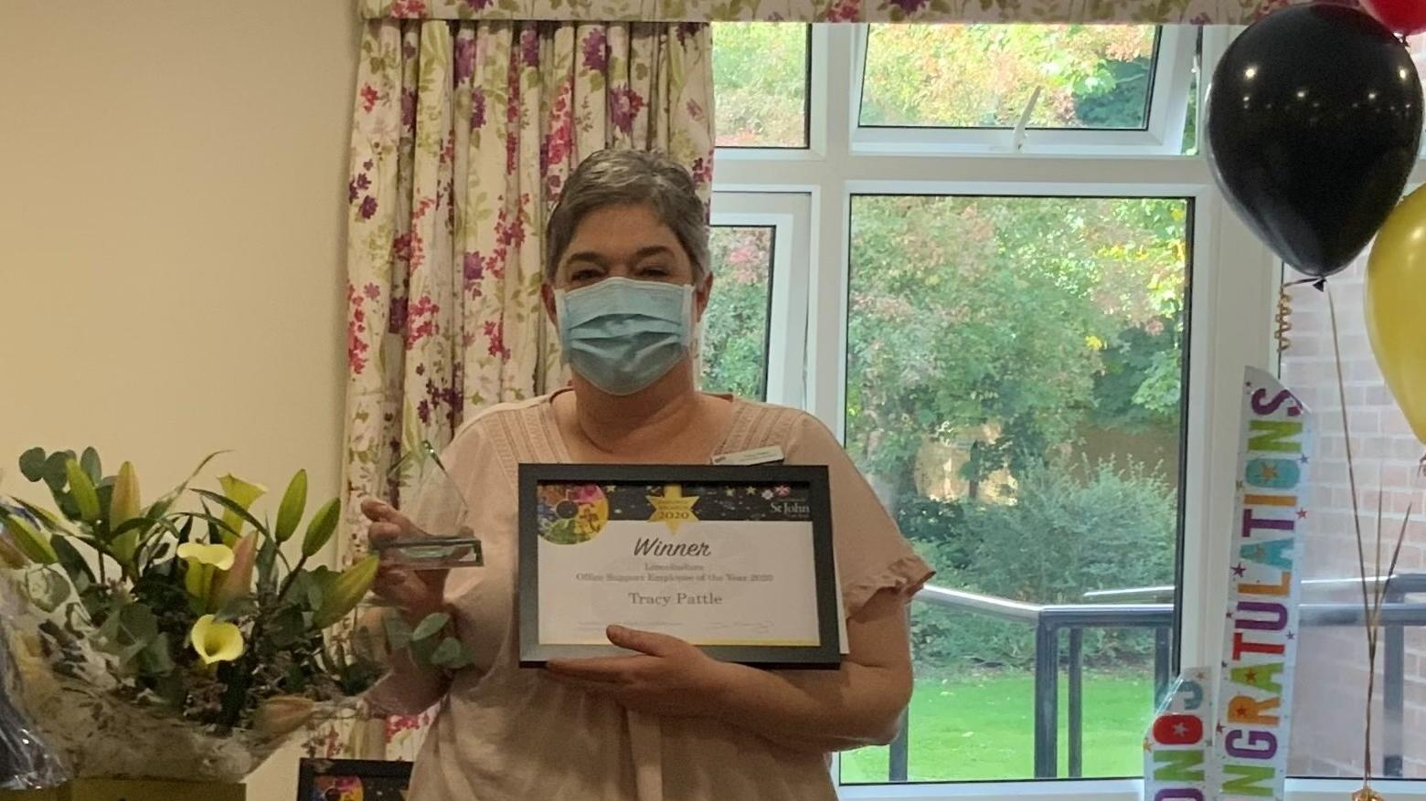 Tracy with Award and Flowers
