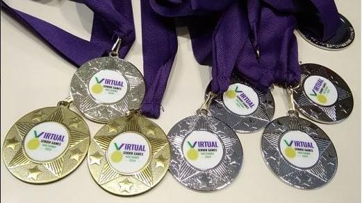 Gold and silver medals from the Virtual Senior Games