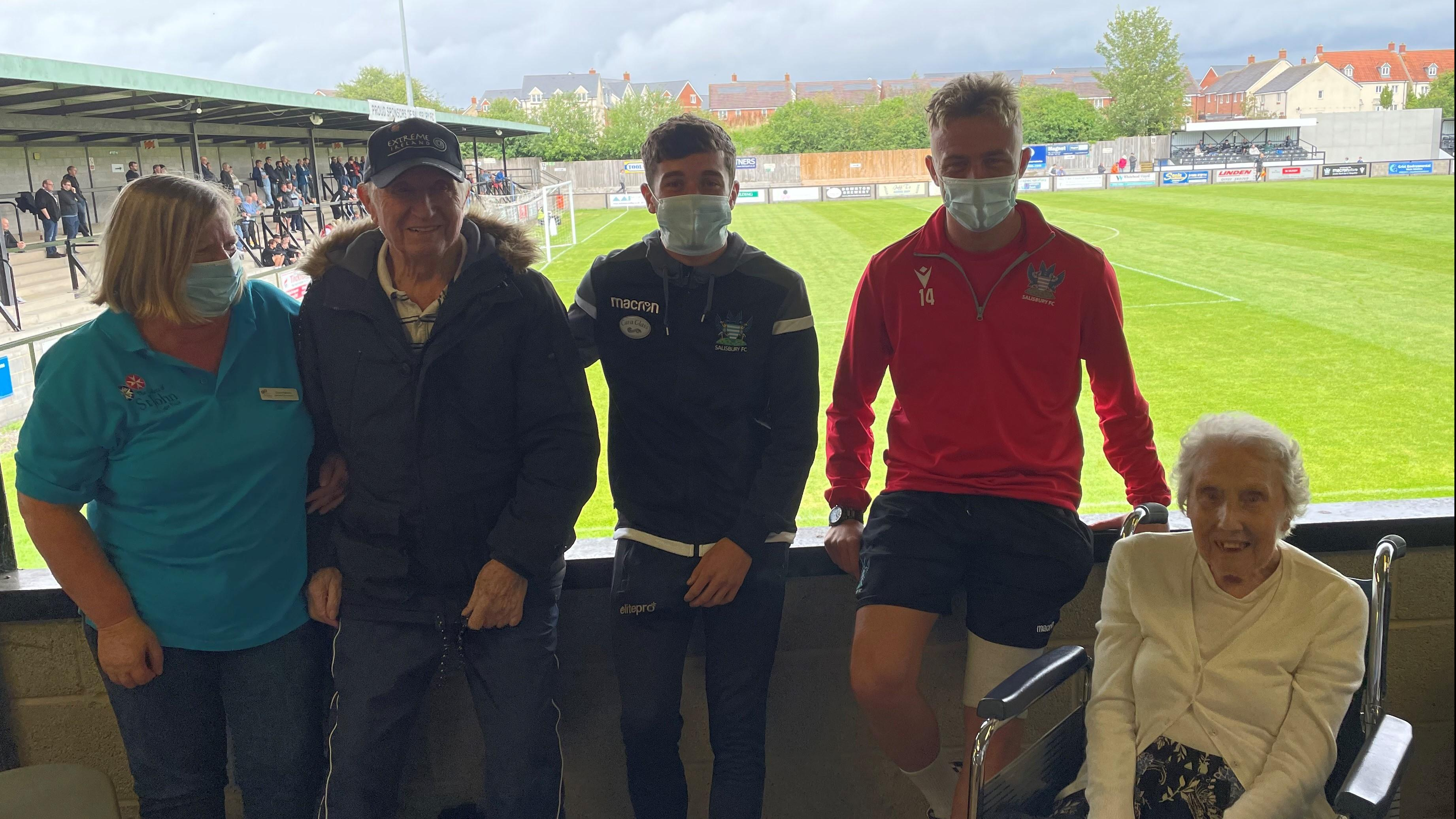 Staff and residents meet Salisbury FC players