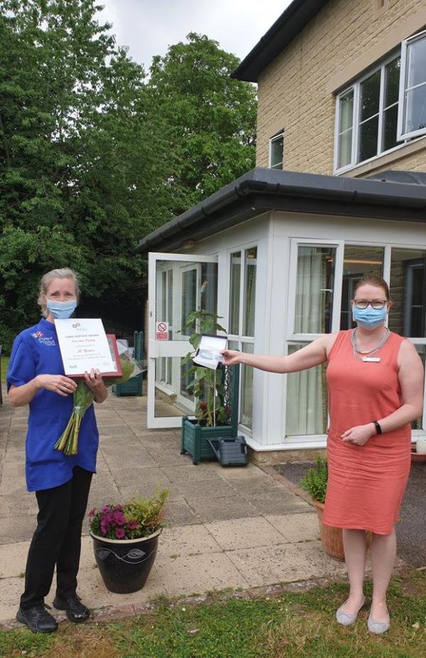 Carer receives award for 30 years' service