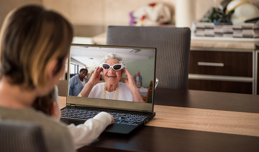 Families communicating via laptop and video call
